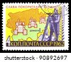 """USSR - CIRCA 1962: A stamp printed in USSR (Russia) shows person measuring the land, map and Tractors with inscription and name of series """"Glory the conquerors of virgin land"""", circa 1962 - stock photo"""