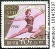 USSR- CIRCA 1960: A stamp printed in USSR shows Women's gymnastics, devoted 17th Olympic Games, Rome, 8/25-9/11, circa 1960 - stock photo