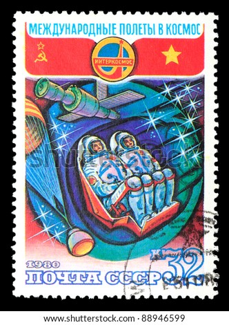 USSR - CIRCA 1980: The stamp printed in USSR shows international flights in space, circa 1980