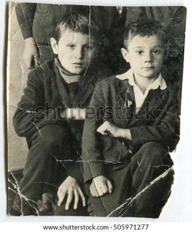 USSR - CIRCA 1985: Vintage photo of the Octobrist boys in school uniform and with Octobrist asterisk