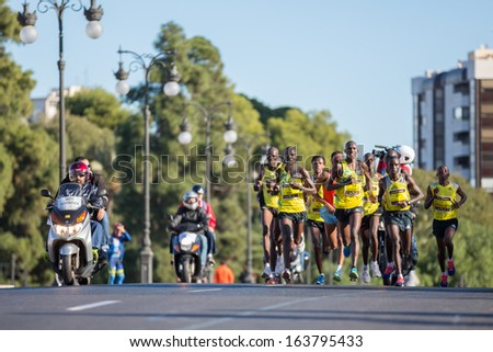 VALENCIA - NOVEMBER 17: Kendagor (number 23) at the head of the leading group of Valencias marathon on November 17, 2013 in Valencia, Spain