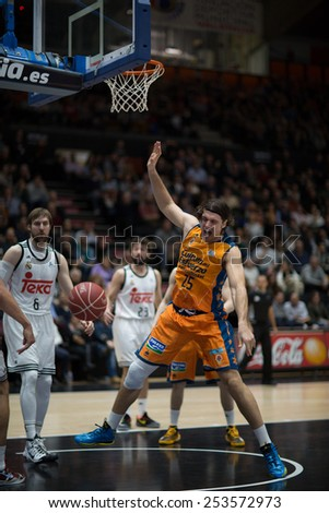 VALENCIA, SPAIN - FEBRUARY 15: Loncar 25 in action during Spanish League match between Valencia Basket Club and Real Madrid at Fonteta Stadium on February 15, 2015 in Valencia, Spain