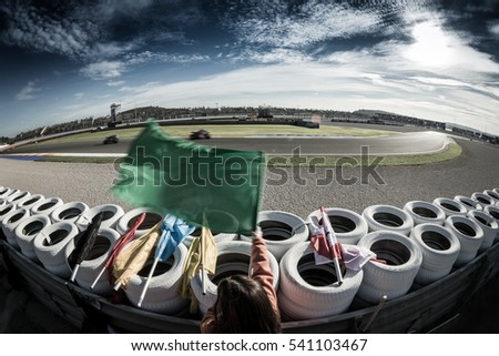 VALENCIA, SPAIN - NOV 12: Race marshall wuth green flag during Motogp Grand Prix of the Comunidad Valencia on November 12, 2016 in Valencia, Spain.