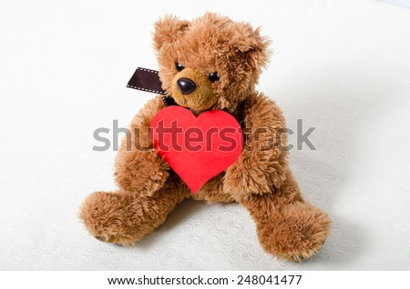 Valentine's Day teddy bear with a heart in his hands