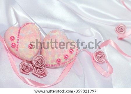 Valentines day card with hearts, decorative roses and ribbons on silk