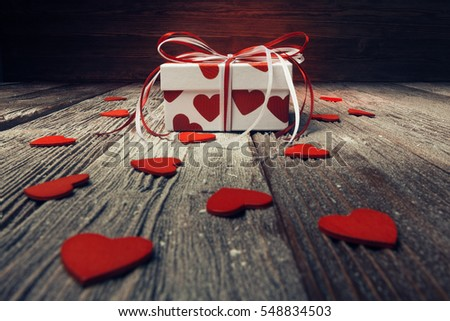 Valentines day concept with gift box and red hearts