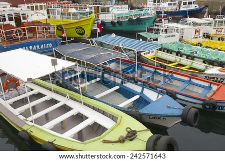 VALPARAISO, CHILE - OCTOBER 19, 2013: Excursion boats parked at the harbor in Valparaiso, Chile.