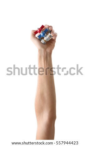 Valves  in man's hand  isolated on white