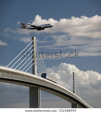 VANCOUVER - April 14, 2012: SkyTrain bridge connecting Vancouver and Richmond was open just before 2010 Winter Olympic Games in Vancouver. Pictured is the bridge and aircraft Boeing 747. BC, Canada .