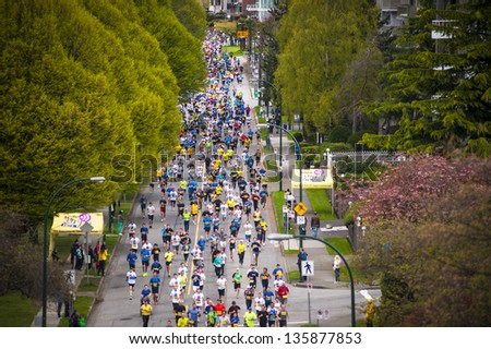 VANCOUVER, CANADA - APRIL 21:  Athletes participate in the 2013 Vancouver Sun Run, April 21, 2013. Many runners wore blue and yellow in support of the Boston marathon, where bombings occurred earlier.