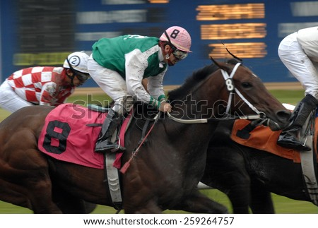 VANCOUVER, CANADA - AUGUST 6, 2012: Horses ridden by jockeys compete at Hastings Park racecourse in Vancouver, Canada, on August 6, 2012.