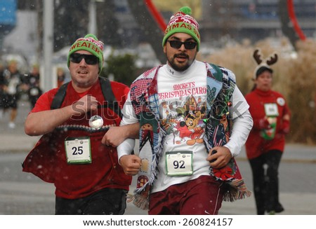 VANCOUVER, CANADA - DECEMBER 13, 2014: Hundreds of runners and walkers celebrated Christmas by participating in The Ugly Sweater Run 5K in Vancouver, Canada, on December 13, 2014.