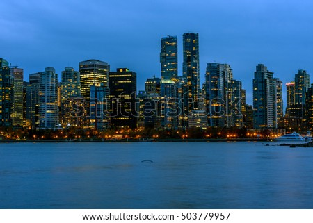 Vancouver, Canada, October 12 2016. Night lights on downtown Vancouver over blue evening sky