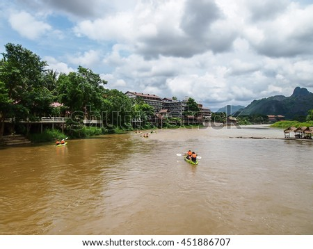 VANG VIENG, LAOS - JUNE 23 : The tourist take a rest in a boat on Nam Song River on june 23, 2016 in Vang Vieng, Laos