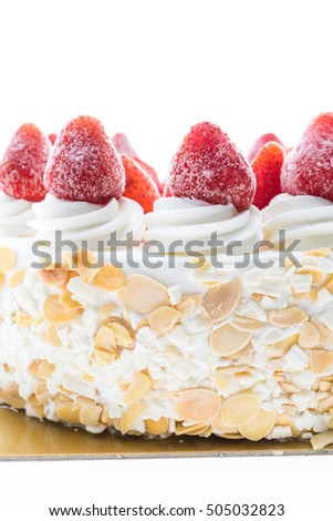 Vanilla ice cream cake with strawberry on top isolated on white background