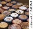 Vanilla muffins with chocolate chips. Shallow depth of field. - stock photo