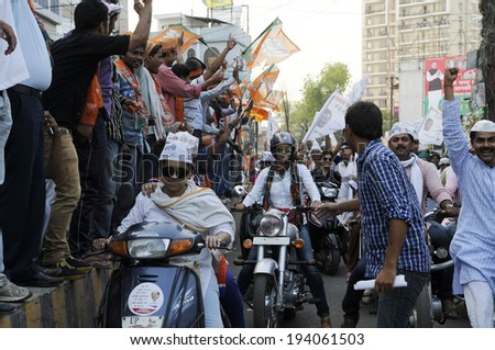 VARANASI - MAY  8:  Bollywood actress  Gul Panag  being stopped  by  rival BJP supporters  during a  motorbike rally  on May  8, 2014 in Varanasi , India.