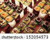 Varieties of cakes individual decorative desserts on the table at a luxury event, gourmet catering sweets - stock photo