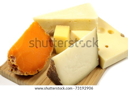 Variety of cheese: parmesan, mimolette, gouda and other hard cheese