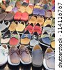 variety of the colorful leather shoes in the shop - stock photo