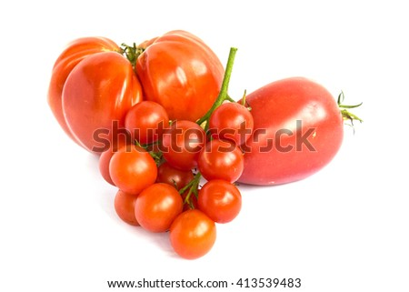 Variety of tomatoes isolated on white background