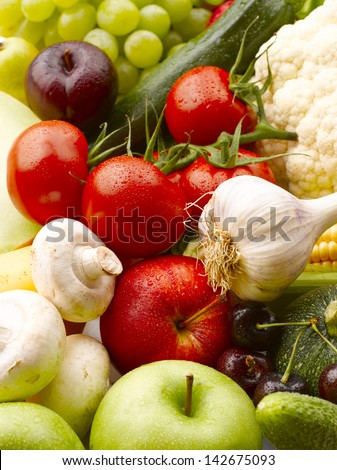 Various, assorted fruits and vegetables(grape, apple, pumpkin, Garlic, mushrooms, cauliflower, corn, maize, tomato, cherry, zucchini, green apple). Vibrant color.