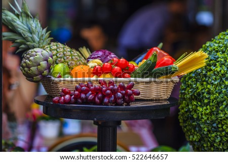 Various fresh fruits and vegetables in wicker basket