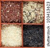 Various kinds of rice in a box - stock photo