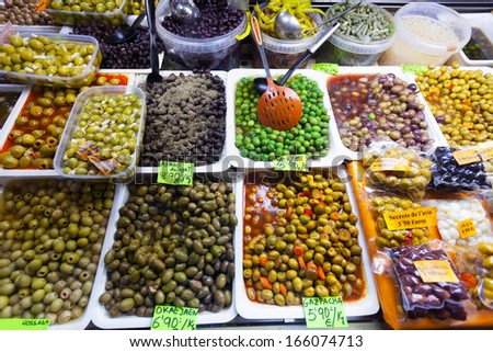 Various marinated olives in cans at Spanish market