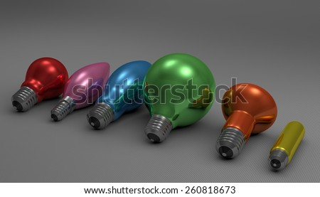 Various multicolor glossy light bulbs lying on gray squared background, perspective view