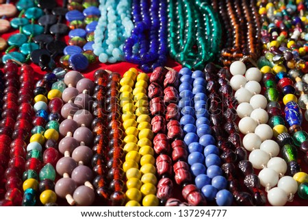 Various of different colorful necklace at Anjuna flea market in Goa, India