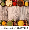 Various spices in wooden bowls - stock photo