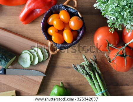 various types of fresh vegetables like tomatoes , red onions, green peppers and red