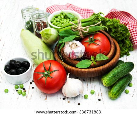 various vegetables on a old wooden background