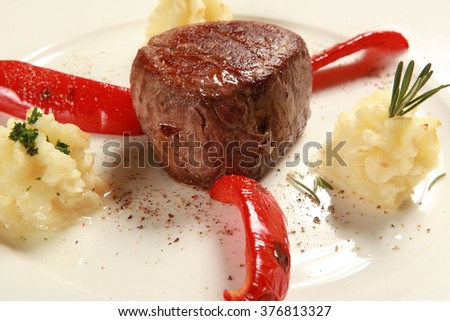 Veal steak with potatoes on a plate