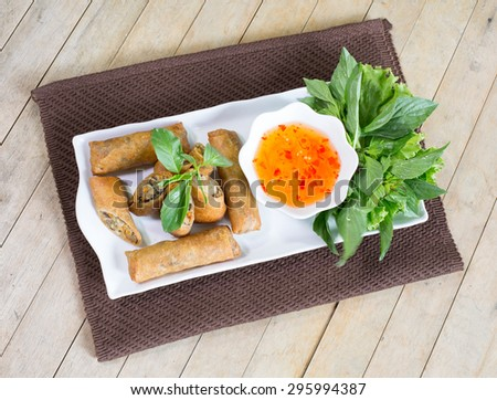 Veg Spring Rolls, on white dish and wooden table