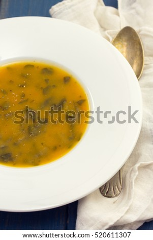 vegetable cream soup on white plate