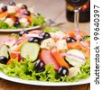 Vegetable salad and glass of red wine - stock photo