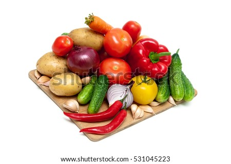 vegetables on a cutting board isolated on white background.