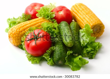 Vegetables: tomatoes, cucumbers and corn. Vivid healthy nutrition. Studio lighting.