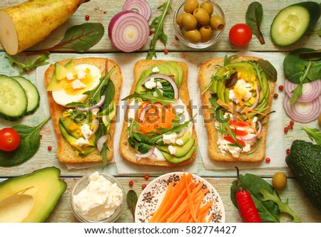 vegetarian sandwich with avocado, cream cheese, cucumber, herbs ...