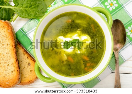 Vegetarian soup with vegetables as carrot, spinach, potatoes, parsley ...