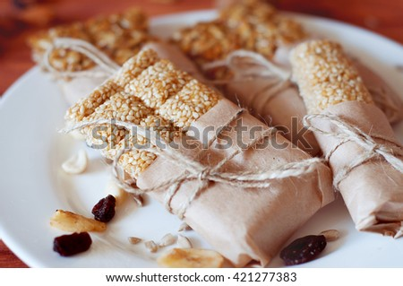 Vegetarian sweets. Granola bars made of sesame seeds, peanuts, cashew nuts, sunflowers seeds, oil and honey.