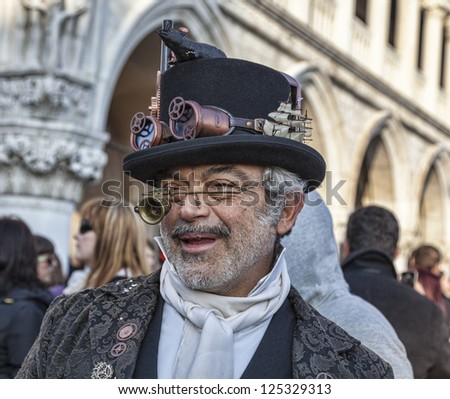 VENICE-FEB 18: Unidentified eccentric man funny disguised on February 18, 2012 in Venice. In 2012 the Venice Carnival was held between 11- 21 February.