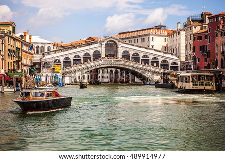 VENICE, ITALY - AUGUST 19, 2016: Vaporetto (passanger boat) at Grand Canal in Venice on August 19, 2016 in Venice, Italy.