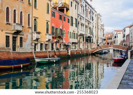VENICE, ITALY - FEB 04, 2015: Scene of canals, bridges and streets, with local and tourists, in Venice, Veneto, Italy