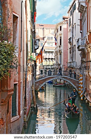 VENICE, ITALY - FEBRUARY 18, 2012: The best way to feel the medieval charm and the spirit of Venice is to take a trip on gondola and to listen the singing of gondolier, on February 18 in Venice.