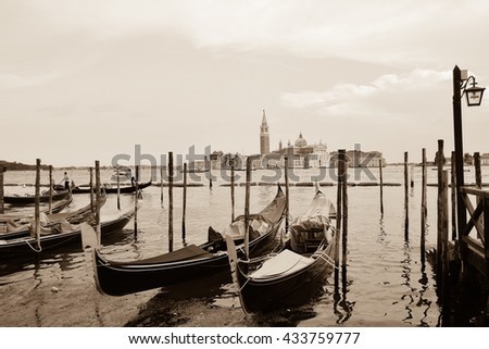 VENICE, ITALY - JUNE 04, 2016 - view of the city of Venice in Italy and its large canal with gondolas and palaces that are reflected in the lagoon Adriatic Sea
