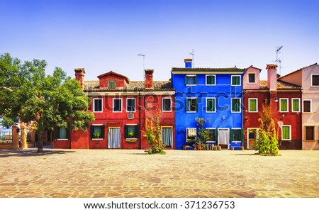 Burano italy sept 26 2014 courtyard stock photo 531913468 for Colorful tree house