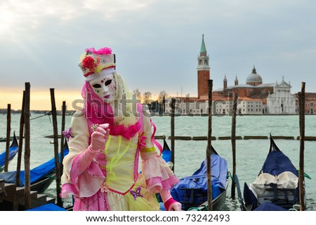 VENICE - MARCH 7: An unidentified masked person in costume in St. Mark's Square during the Carnival of Venice on March 7, 2011 in Venice. The 2011 carnival was held from February 26th to March 8th.